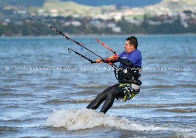 Windsurfer sailing against the elements