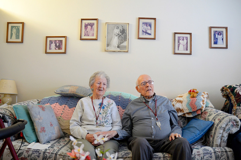 Marie and Arthur Farnsworth of Leominster have been married for 66 years and are going on 67, Thursday at Manor On the Hill. Above them on the wall is their wedding photo (largest one) from June 21, 1947, amongst wedding photos of their children.<br /> SENTINEL & ENTERPRISE / BRETT CRAWFORD