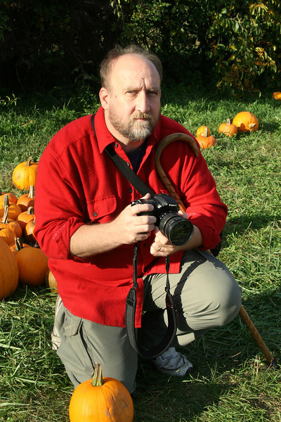 Mark Urbin with a camera and a cane.