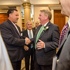 Rollstone Bank President and CEO Martin Connors, Jr. greets Tony Emerson, President and CEO of IC Credit Union, before being honored as Distinguished Citizen by the Nashua Valley Boy Scouts in a ceremony at the DoubleTree by Hilton Hotel in Leominster on Wednesday evening. SENTINEL & ENTERPRISE / Ashley Green