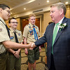 Rollstone Bank President and CEO Martin Connors, Jr. greets Moses Rivera, of Fitchburg Boy Scout Troop 41, before being honored as Distinguished Citizen by the Nashua Valley Boy Scouts in a ceremony at the DoubleTree by Hilton Hotel in Leominster on Wednesday evening. SENTINEL & ENTERPRISE / Ashley Green