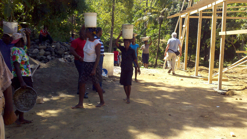 Carrying gravel from river bottom to job site for transitional church/school – St. Andre', Mithon.