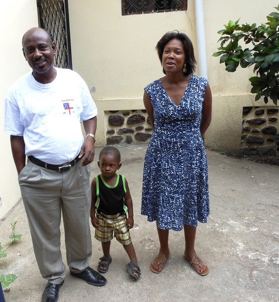 """Fr. Samuel, his wife and """"little"""" Sammy – priest in charge of 8 parishes including St. Andre'"""