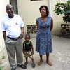 "Fr. Samuel, his wife and ""little"" Sammy – priest in charge of 8 parishes including St. Andre'"