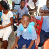 """Vampire teeth"" – what fun!  The children at Mithon have fun with their gifts – St. Andre' school."