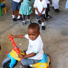 """Watch out for my Big Wheel"" <br /> Trinity School - Port au Prince"
