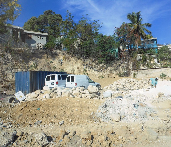 Rubble still being moved by hand, wheelbarrow and small trucks – Port au Prince.