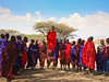 The men wear,traditionally, red capes. It's believed that lions will give them a wide berth when they see red. Walking through vast arid lands with their cattle herds, they are armed only with clubs.