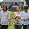 Attorney general Maura Healey visits Mill City Grows' Urban Farm in Pawtucketville. From left, Mill City Grows executive director Francey Slater, director of programs Jessica Wilson, and attorney general Maura Healey. (SUN/Julia Malakie)