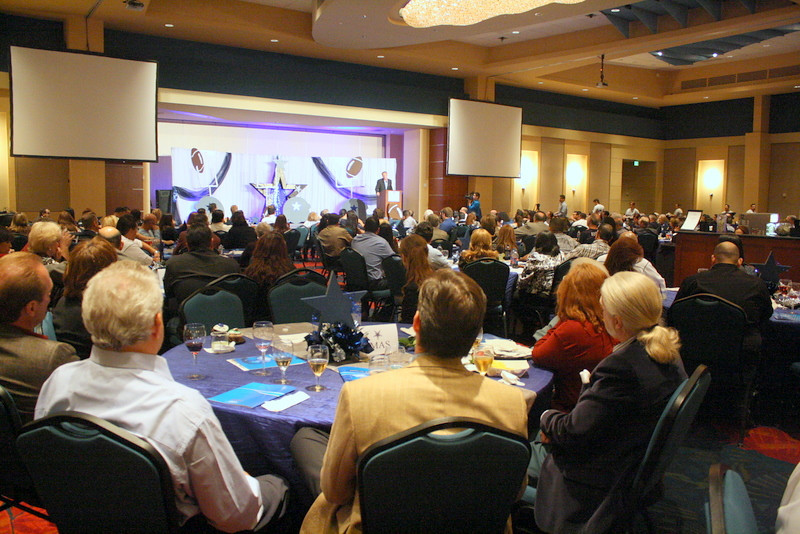 """Daryl """"the Moose"""" Johnston addresses the crowd at this year's McAllen Chamber of Commerce Awards Banquet."""