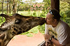 "044. 10 June 2009 - The Kiss<br /> <br /> For a change, a bit of fun, and something of me.<br /> <br /> As you may have gathered, I am currently in Kenya. The weekends here are amazing... no lack of adventure.<br /> <br /> Meet ""Daisy"". Now this is a unique experience, simply amazing. This is me, ""feeding"" Daisy the giraffe at a giraffe sanctuary. Now this may seem gross, but here is an interesting fact. The saliva of a giraffe is actually anti-septic. Nevermind that the tongue is like sand-paper. Still, I enjoyed the experience, it is really thrilling getting so close to nature."