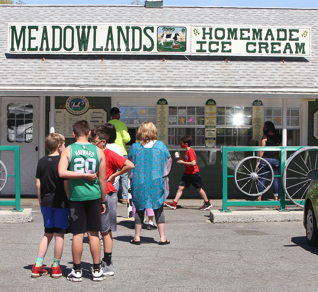 Meadowlands Ice Cream in Tewksbury is busy on a warm spring afternoon. (SUN/Julia Malakie)