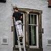 Man up a ladder