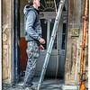 Man Contemplates Ladder