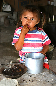 Mayan village child eating near Xel Ha