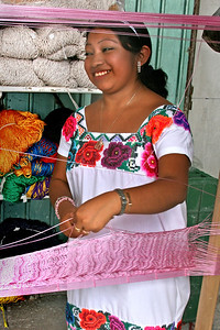 Mexican woman weaving hammock
