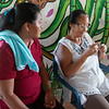 Luz Dary accompanies a member of MEMPA during the first steps in weaving a mochila.