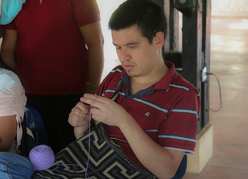 Carlos also learns to weave.