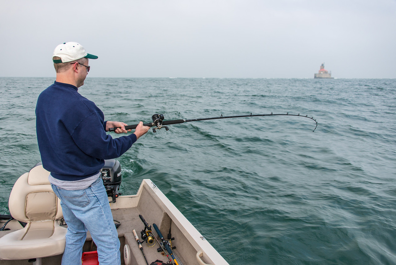 Eric fighting a Smallmouth Bass near Port Austin Reef Lighthouse - October 2013