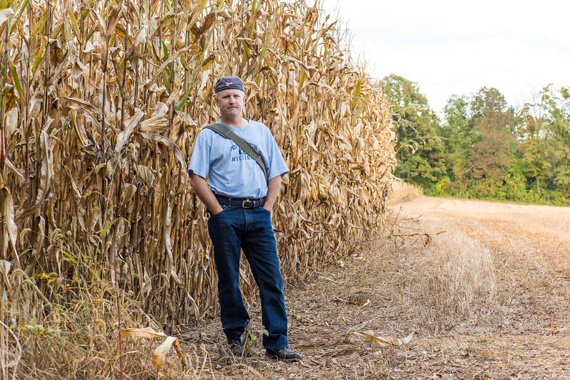 A Michigander next to tall cornstalks near Beltzville State Park - September 2013