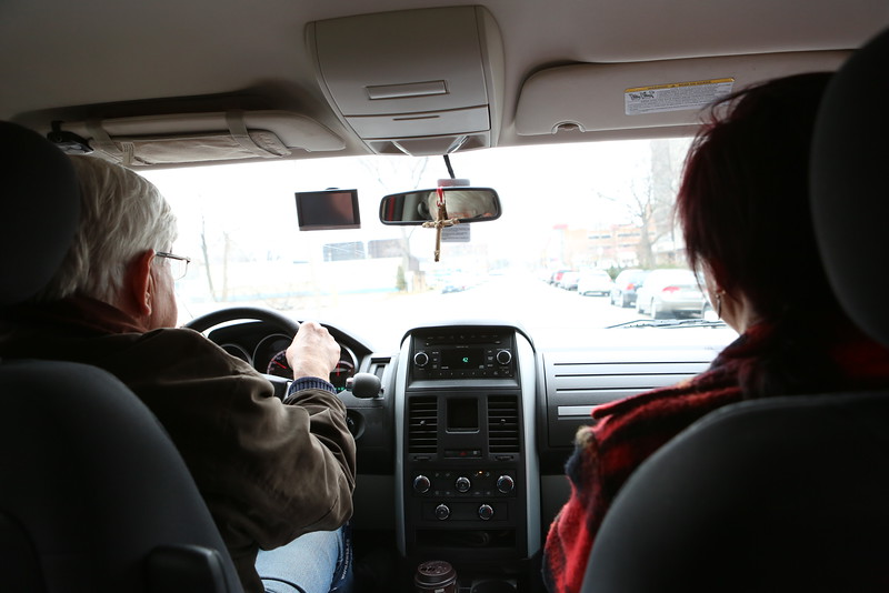 Michael Rovers and Karen Morand driving to their next house call.