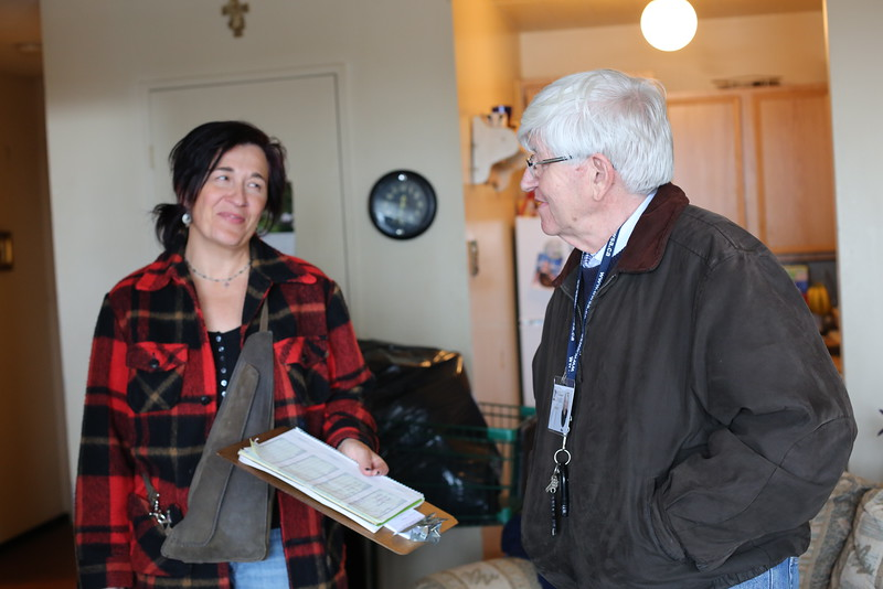 Karen Morand and Michael Rovers share a laugh while making a house call to a client.