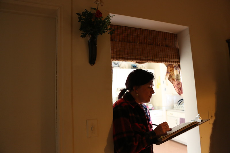 Karen Morand fills out receipts for the grocery gift cards they give out to clients.