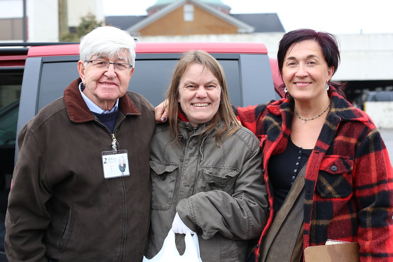 Michael Rovers and Karen Morand pose with Sheri Elliott, a past client of 2nd Chance Ministry.