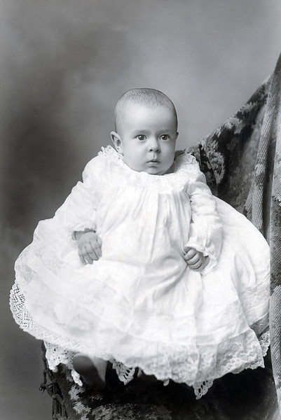 Vernon F. Raver the first son of Minnie Raver. Vernon was born in October of 1904 and he looks about six months here so this portrait was made sometime in 1905. Vernon did not fare as well as his sisters, they all lived into their nineties, but Vernon died just short of sixty.