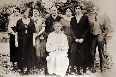 I recognize two people in this 1924 photograph. The second woman from the left with a white tassel necklace is my great-grandmother Minner Raver and the man on the far right is her brother Bill. I suspect the woman seated in the middle of the group is Minnie's mother Elizabeth Fulk. If so this is the best picture I have found of this great-great-grandmother. Elizabeth died in 1925 so this would have been one of the last pictures of her. I know this photograph mattered to my great-grandmother because she put it in a curved oval frame and hung it on her walls for many years. I recovered the curved print from my mother's collection and snapped a few macro shots of it today. The image is still curved and cannot be scanned with a flatbed. It's in poor shape and was probably never all that good but it meant a lot to Minnie.