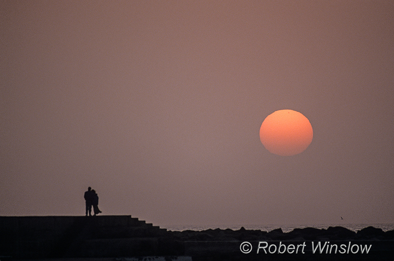 NoMR, Silhouette of two people at Sunset, Swakopmund, Namibia, Africa