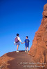 Model Released, Woman age 52 and Boy age 10, Holding hands, Hiking, Arches National Park, Utah, USA, North America