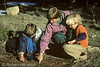 Model Released, Mother, two boys, examining animal tracks, Wyoming