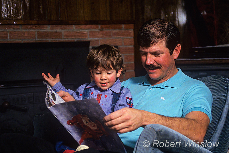 Model Released, Father and son, reading together