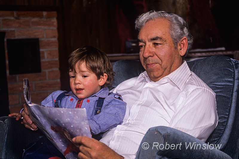 Model Released, Grandfather, reading to grandson, Hispanic family