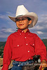 Model Released, Young Boy, Sitting in a Saddle, wearing a cowboy hat, Colorado