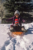 Model Released, Boy, 3 years old, sledding, with Aunt, Winter, Crested Butte, Colorado, USA, North America
