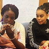 Miss Massachusetts USA Allissa Latham answers questions from teens during a visit to Girls Inc. in Lowell. Ashley Agyeman, left, and Jojo Hanger-Brown look at Miss Massachusetts' crown as it's passed around. At lower right is Janiyah Thompson-Williams. (SUN/Julia Malakie)