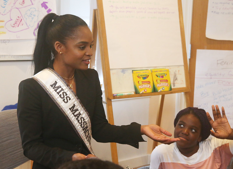Miss Massachusetts USA Allissa Latham answers questions from teens during a visit to Girls Inc. in Lowell. At right is Ashley Agyeman. (SUN/Julia Malakie)
