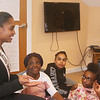 Miss Massachusetts USA Allissa Latham answers questions from teens during a visit to Girls Inc. in Lowell. Listening, from left: Ashley Agyeman, Jojo Hanger-Brown, Janiyah Thompson-Williams and Margretta Quaye. (SUN/Julia Malakie)