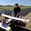 Rich Anderson, president of the Boulder Model Airplane Club, puts together a plane at the club site, near the Boulder Reservoir.<br /> Cliff Grassmick / June 18, 2010