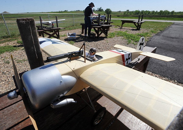 Rich Anderson, background, president of the Boulder Model Airplane Club, puts together a plane at the club site, near the Boulder Reservoir. A WWI German fighter is in the foreground.<br /> Cliff Grassmick / June 18, 2010