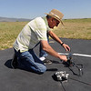 Al Coelho, a member of the Boulder  Model Airplane Club, prepares to launch a helicopter at the club site near Boulder Reservoir.<br /> Cliff Grassmick / June 18, 2010