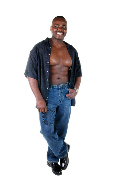 Black muscular man in jeans and unbuttoned shirt isolated on white background