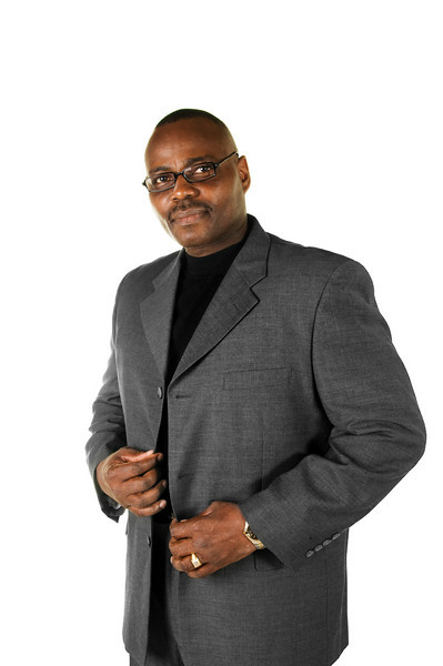 Black male model with glasses in sport coat on white background
