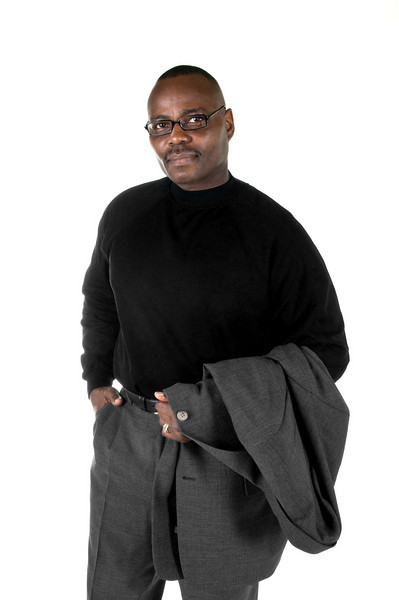 Black (African American) male in suit and long sleeve shirt isolated on white background