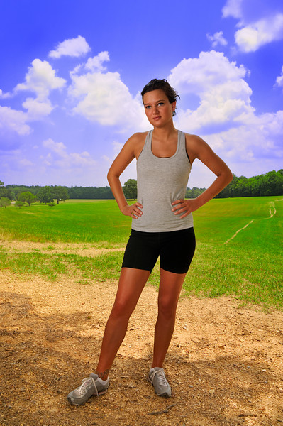Beautiful young lady prepares for a run