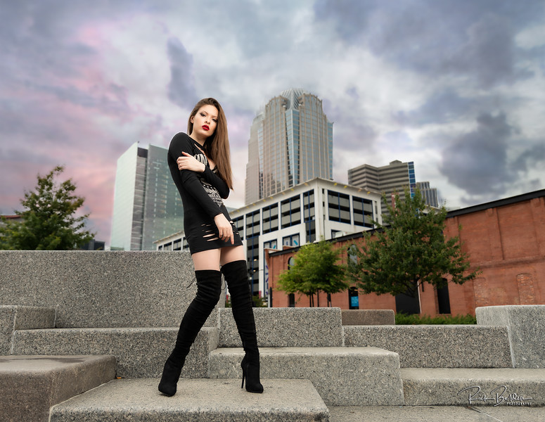 A vibrant Sunset was trying to come in through the storm clouds. Creating with my friend Lexi in downtown Charlotte.  Model: @redhot_rebellion_  MUA: @gabrielle.elise26  Clothing: @windsorstore       ..........................................................