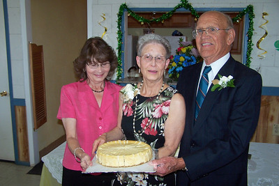 Carol Whitley and Wanda and Willie Moeller with cheesecake. Wanda and Willie Moeller's 50th Wedding Anniversary Celebration, Gila Mt. RV Park, Yuma, AZ. Mar. 10, 2012.