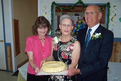 Carol Whitley and Wanda and Willie Moeller with cheesecake. Wanda and Willie Moeller's 50th Wedding Anniversary Celebration, Gila Mt. RV Park, Yuma, AZ. Mar. 10, 2012.